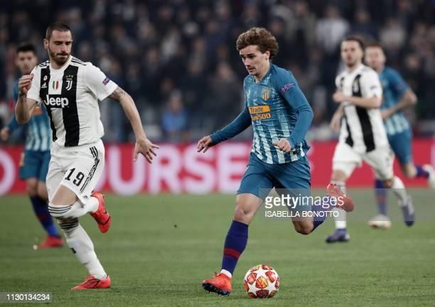 Atletico Madrid's French forward Antoine Griezmann outruns Juventus' Italian defender Leonardo Bonucci during the UEFA Champions League round of 16...