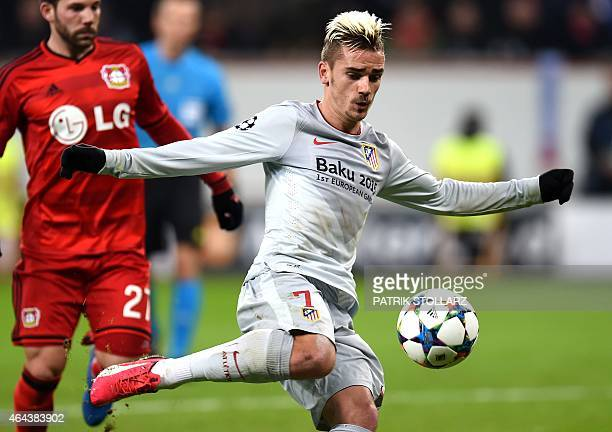 Atletico Madrid's French forward Antoine Griezmann plays the ball during the UEFA Champions League firstleg round of 16 football match Bayer 04...