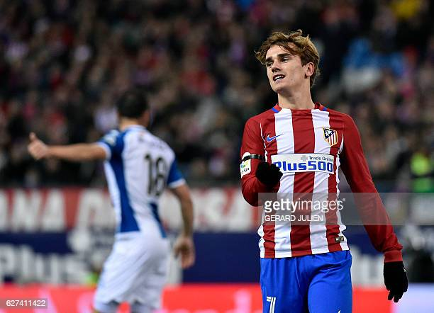 Atletico Madrid's French forward Antoine Griezmann reacts after missing a goal opportunity during the Spanish league football match Club Atletico de...