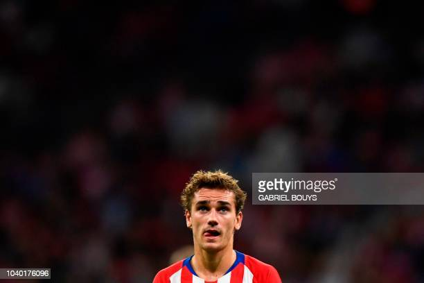 Atletico Madrid's French forward Antoine Griezmann reacts during the Spanish league football match Club Atletico de Madrid against SD Huesca at the...