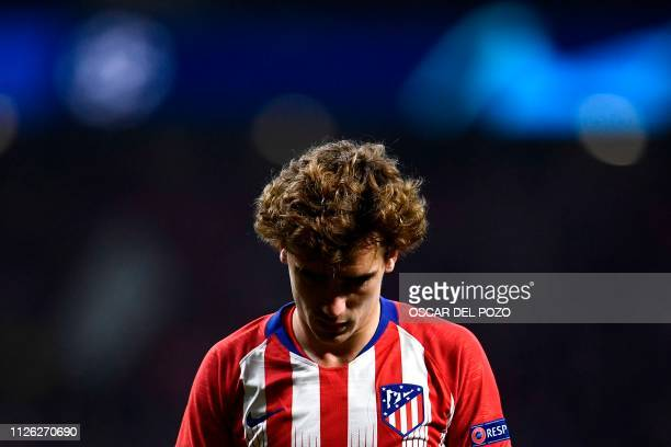 Atletico Madrid's French forward Antoine Griezmann reacts during the UEFA Champions League round of 16 first leg football match between Club Atletico...
