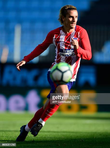 Atletico Madrid's French forward Antoine Griezmann runs for the ball during the Spanish league football match RC Celta de Vigo vs Club Atletico de...