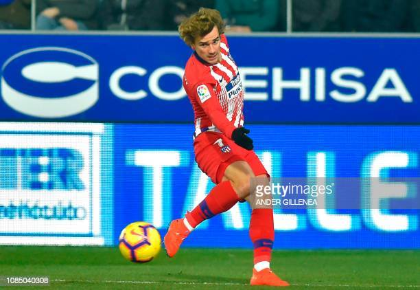 Atletico Madrid's French forward Antoine Griezmann runs with the ball during the Spanish League football match between Athletic Club Bilbao and...