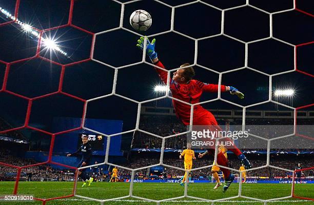 TOPSHOT Atletico Madrid's French forward Antoine Griezmann scores a goal past Barcelona's German goalkeeper MarcAndre Ter Stegen during the Champions...