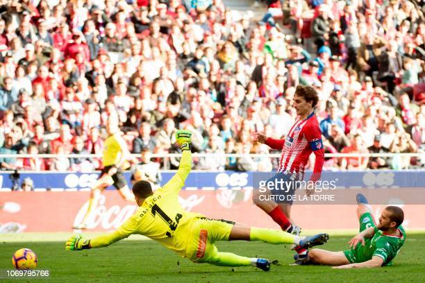 Atletico Madrid's French forward Antoine Griezmann scores a goal during the Spanish league football match between Club Atletico de Madrid and...