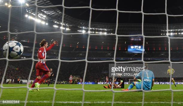 Atletico Madrid's French forward Antoine Griezmann scores the 02 goal past Leverkusen's goalkeeper Bernd Leno during the UEFA Champions League round...