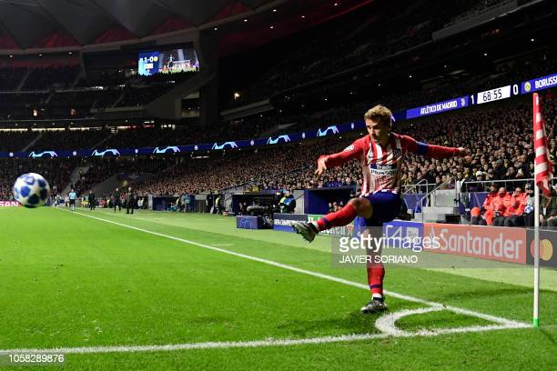 Atletico Madrid's French forward Antoine Griezmann shoots from the corner during the UEFA Champions League group A football match between Club...
