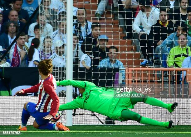 Atletico Madrid's French forward Antoine Griezmann shoots to score a goal during the Spanish league football match Real Madrid CF vs Club Atletico de...