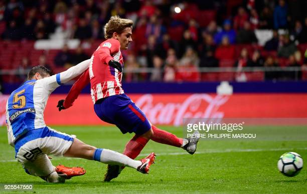 Atletico Madrid's French forward Antoine Griezmann shoots to score a goal during the Spanish league football match Club Atletico de Madrid against...
