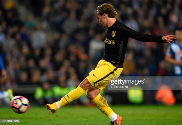 Atletico Madrid's French forward Antoine Griezmann shoots to scores a goal during the Spanish league football match RCD Espanyol vs Club Atletico de...