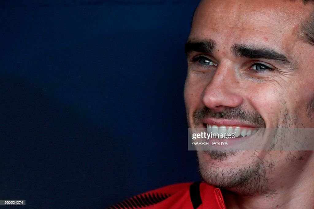 Atletico Madrid's French forward Antoine Griezmann smiles on the bench during the Spanish league football match between Club Atletico de Madrid and SD Eibar at the Wanda Metropolitano stadium in Madrid on May 20, 2018.