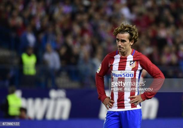 Atletico Madrid's French forward Antoine Griezmann stands on the pitch during the Spanish league football match Club Atletico de Madrid vs Villarreal...