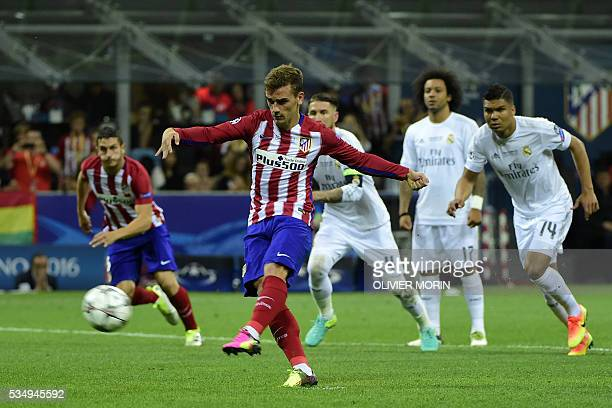 Atletico Madrid's French forward Antoine Griezmann takes a penalty kick during the UEFA Champions League final football match between Real Madrid and...