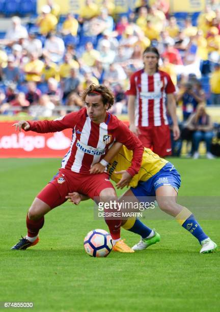 Atletico Madrid's French forward Antoine Griezmann vies with a player of Las Palmas during the Spanish league football match UD Las Palmas vs Club...