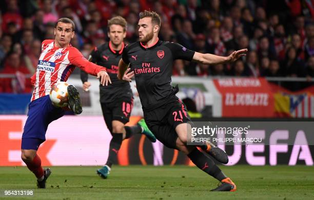 Atletico Madrid's French forward Antoine Griezmann vies with Arsenal's English defender Calum Chambers during the UEFA Europa League semifinal second...