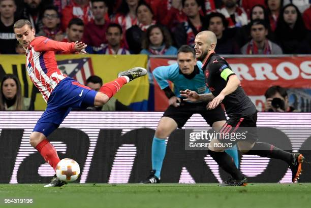 Atletico Madrid's French forward Antoine Griezmann vies with Arsenal's English midfielder Jack Wilshere during the UEFA Europa League semi-final...
