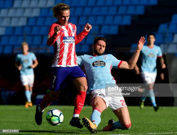 Atletico Madrid's French forward Antoine Griezmann vies with Celta Vigo's defender Sergi Gomez during the Spanish league football match RC Celta de...