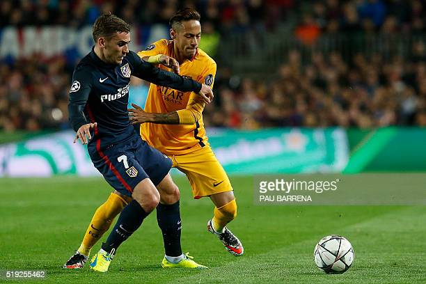 Atletico Madrid's French forward Antoine Griezmann vies with Barcelona's Brazilian forward Neymar during the UEFA Champions League quarter finals...