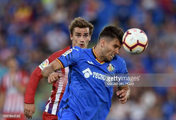 Atletico Madrid's French forward Antoine Griezmann vies with Getafe's Uruguayan defender Leandro Cabrera during the Spanish league football match...
