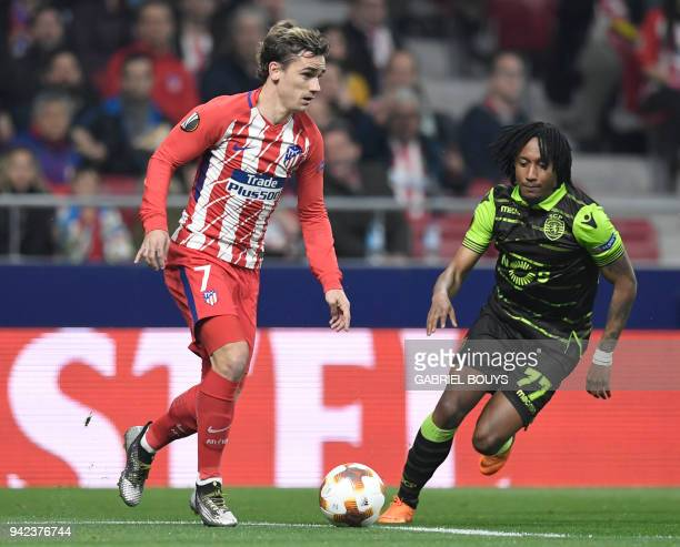 Atletico Madrid's French forward Antoine Griezmann vies with Sporting's Portuguese forward Gelson Martins during the UEFA Europa League quarterfinal...