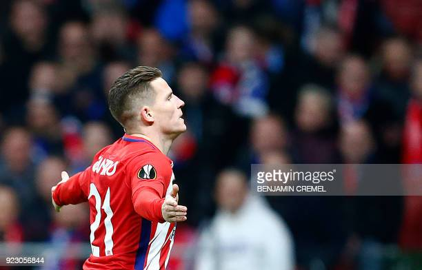 Atletico Madrid's French forward Kevin Gameiro celebrates a goal during the Europa League Round of 32 second leg football match between Club Atletico...
