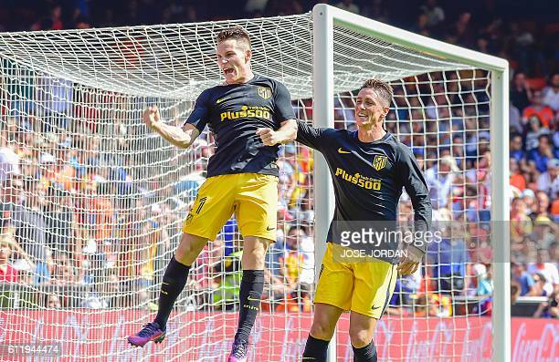 Atletico Madrid's French forward Kevin Gameiro celebrates a goal with Atletico Madrid's forward Fernando Torres during the Spanish league football...