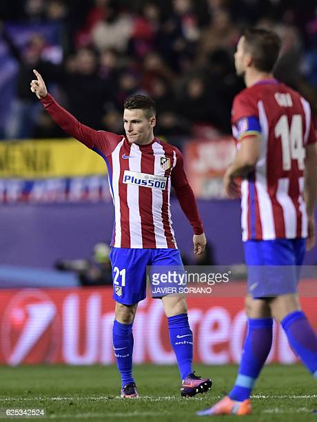 Atletico Madrid's French forward Kevin Gameiro celebrates after scoring a goal during the UEFA Champions League Group D football match Club Atletico...