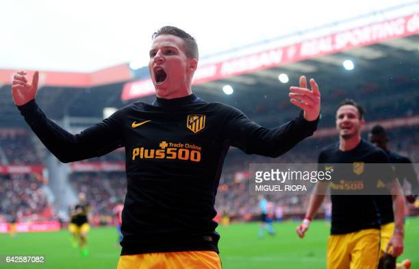Atletico Madrid's French forward Kevin Gameiro celebrates after scoring a goal during the Spanish league football match Real Sporting de Gijon vs...