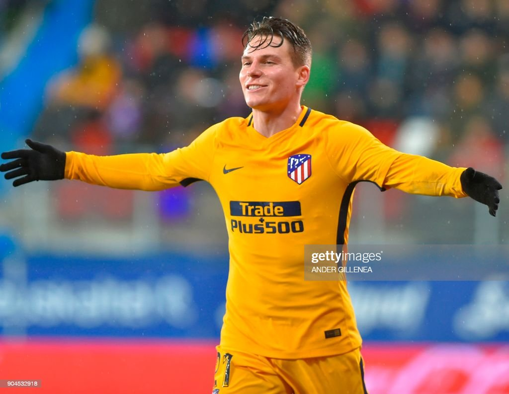 Atletico Madrid's French forward Kevin Gameiro celebrates after scoring his team's first goal during the Spanish league football match between SD Eibar and Club Atletico de Madrid at the Ipurua stadium in Eibar on January 13, 2018. /