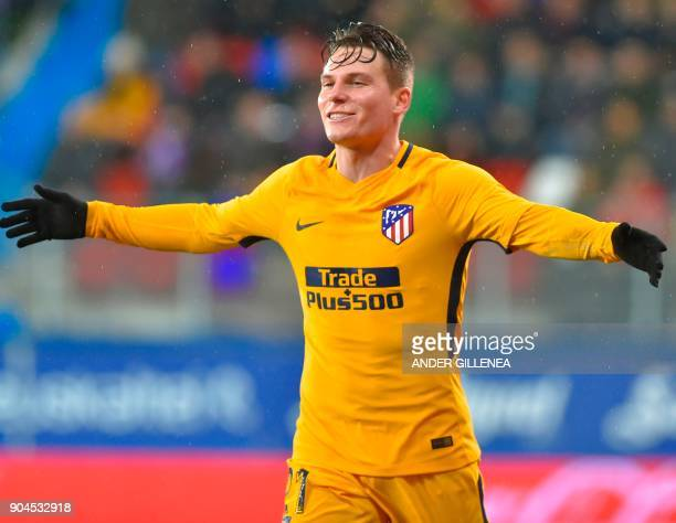 Atletico Madrid's French forward Kevin Gameiro celebrates after scoring his team's first goal during the Spanish league football match between SD...