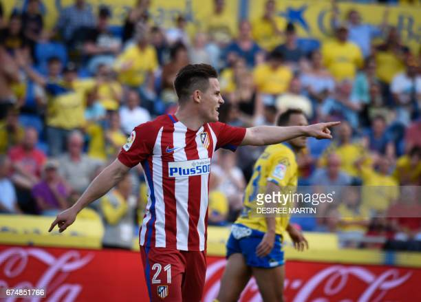 Atletico Madrid's French forward Kevin Gameiro celebrates after scoring during the Spanish league football match UD Las Palmas vs Club Atletico de...