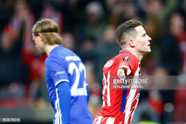 Atletico Madrid's French forward Kevin Gameiro celebrates after scoring the opening goal during the Europa League Round of 32 second leg football...