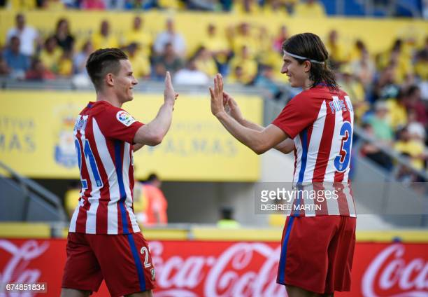 Atletico Madrid's French forward Kevin Gameiro celebrates with Atletico Madrid's Brazilian defender Filipe Luis after scoring during the Spanish...