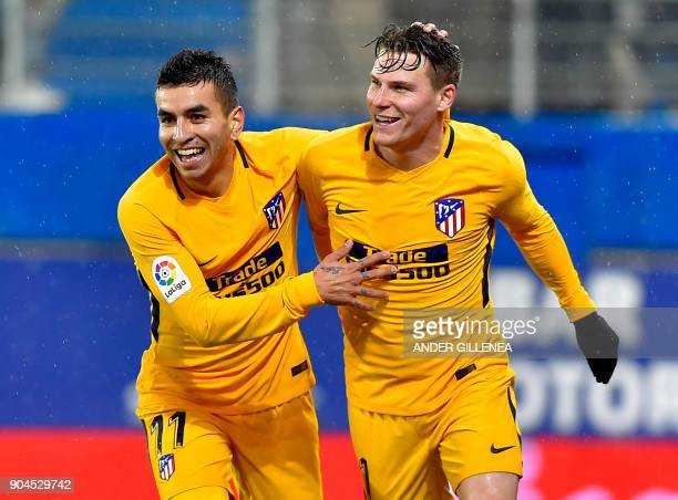 Atletico Madrid's French forward Kevin Gameiro is congtratulated by teammate Argentinian forward Angel Correa after scoring his team's first goal...