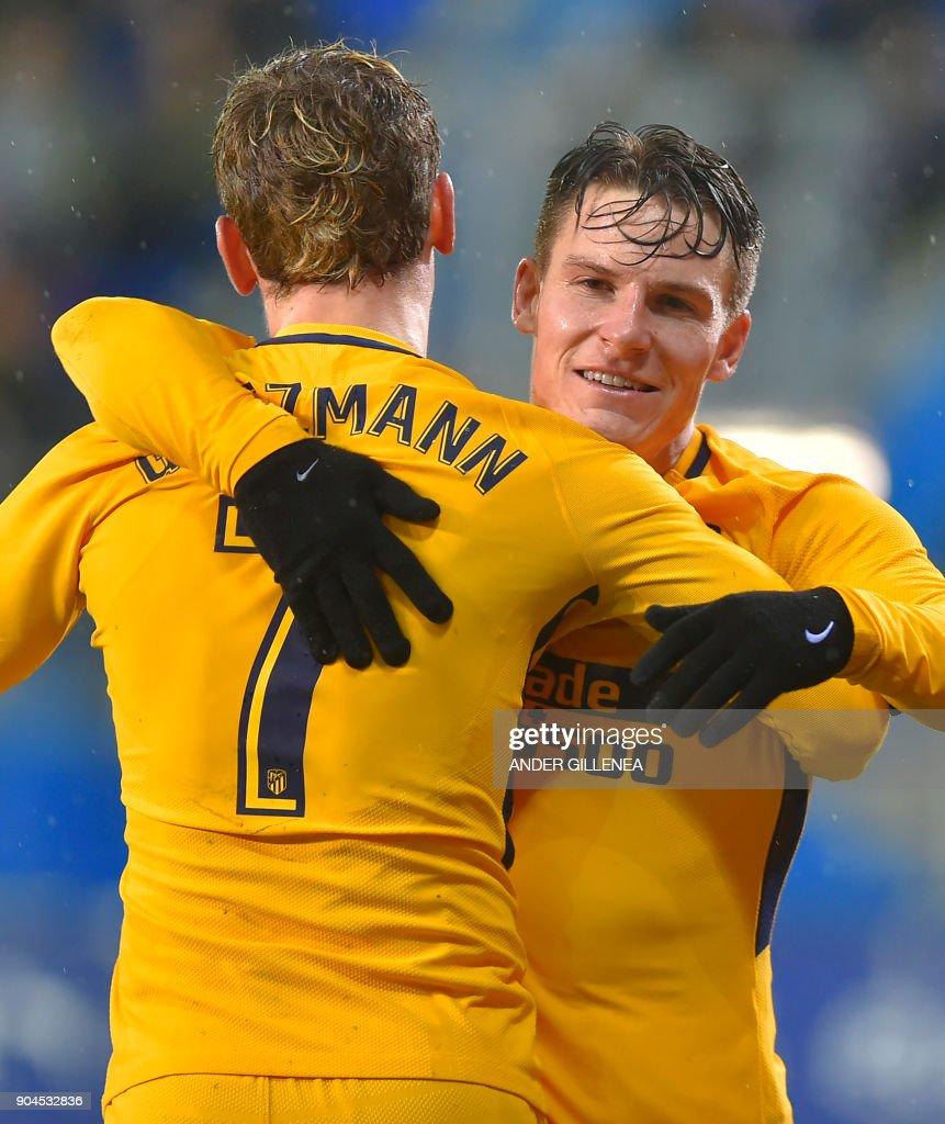 Atletico Madrid's French forward Kevin Gameiro (R) is congtratulated by teammate French forward Antoine Griezmann after scoring his team's first goal during the Spanish league football match between SD Eibar and Club Atletico de Madrid at the Ipurua stadium in Eibar on January 13, 2018. /