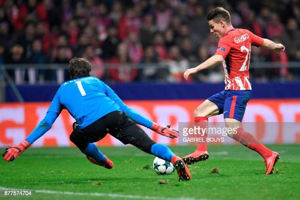 Atletico Madrid's French forward Kevin Gameiro prepares to score past Roma's Brazilian goalkeeper Alisson during the UEFA Champions League group C...