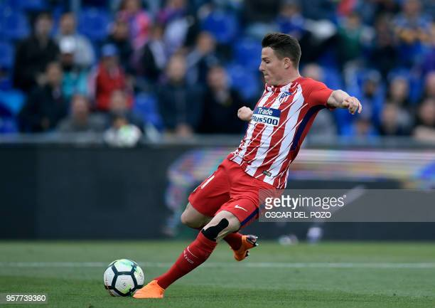 Atletico Madrid's French forward Kevin Gameiro shoots the ball during the Spanish league football match between Getafe and Atletico Madrid at the...