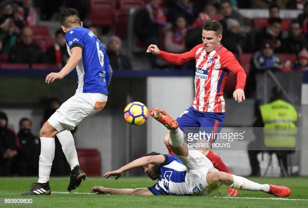 Atletico Madrid's French forward Kevin Gameiro vies with Alaves' Spanish defender Ruben Duarte during the Spanish league football match Club Atletico...