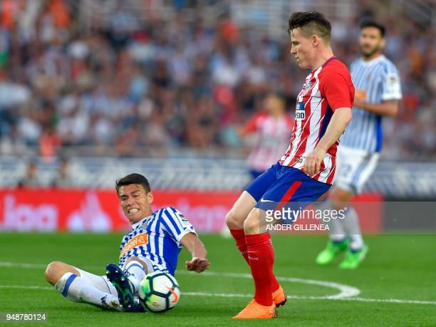 Atletico Madrid's French forward Kevin Gameiro vies with Real Sociedad's Mexican defender Hector Moreno during the Spanish league football between...