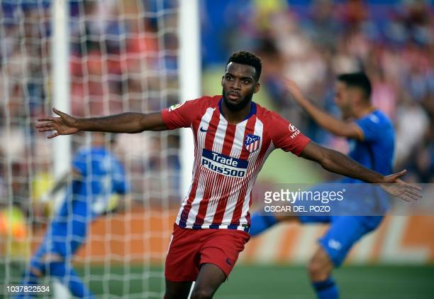 Atletico Madrid's French midfield Lemar celebrates after scoring during the Spanish league football match between Getafe CF and Club Atletico de...
