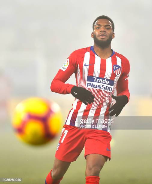 Atletico Madrid's French midfielder Thomas Lemar eyes the ball during the Spanish League football match between SD Huesca and Atletico Madrid at the...