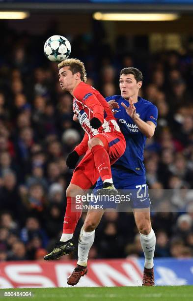 Atletico Madrid's French striker Antoine Griezmann heads the ball past Chelsea's Danish defender Andreas Christensen during a UEFA Champions League...