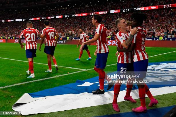 Atletico Madrid's Ghanaian midfielder Thomas celebrates with teammates after scoring during the Spanish league football match Club Atletico de Madrid...