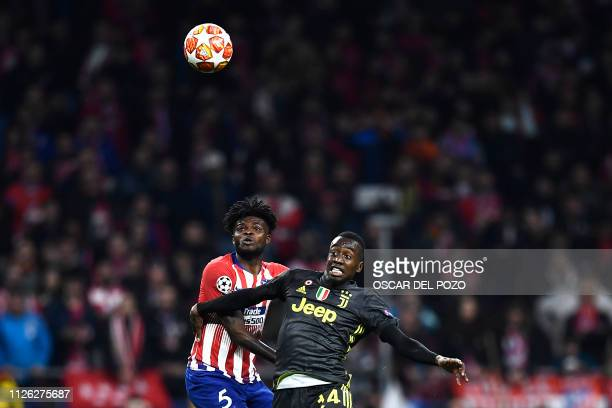 Atletico Madrid's Ghanaian midfielder Thomas challenges Juventus' French midfielder Blaise Matuidi during the UEFA Champions League round of 16 first...