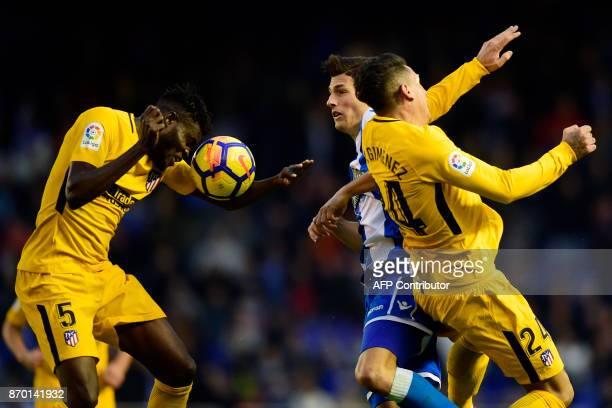 Atletico Madrid's Ghanaian midfielder Thomas Partey and Atletico Madrid's Uruguayan defender Jose Maria Gimenez challenge Deportivo La Coruna's Swiss...