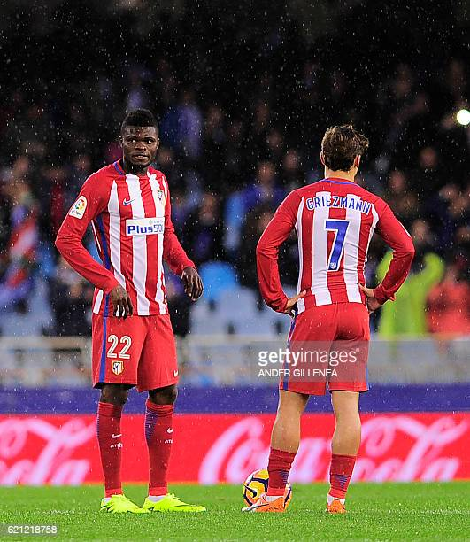 Atletico Madrid's Ghanaian midfielder Thomas Partey and French forward Antoine Griezmann wait to kickoff after Real Sociedad scored their second goal...