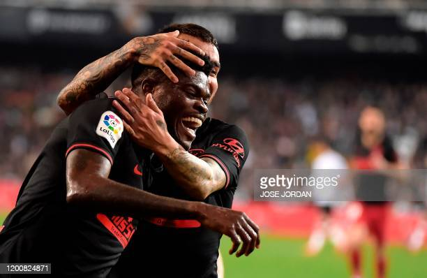 Atletico Madrid's Ghanaian midfielder Thomas Partey celebrates with Atletico Madrid's Argentine forward Angel Correa after scoring during the Spanish...
