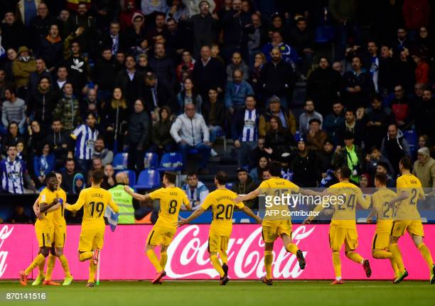 TOPSHOT Atletico Madrid's Ghanaian midfielder Thomas Partey celebrates with teammates after scoring a goal during the Spanish league football match...