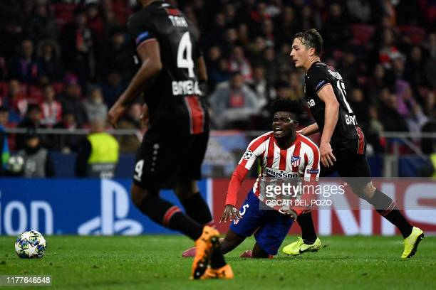 Atletico Madrid's Ghanaian midfielder Thomas Partey falls down during the UEFA Champions League Group D football match between Atletico Madrid and...