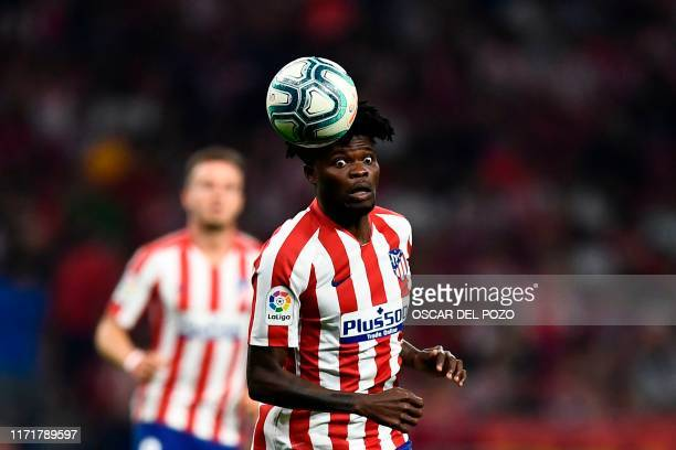 Atletico Madrid's Ghanaian midfielder Thomas Partey heads the ball during the Spanish league football match between Club Atletico de Madrid and Real...